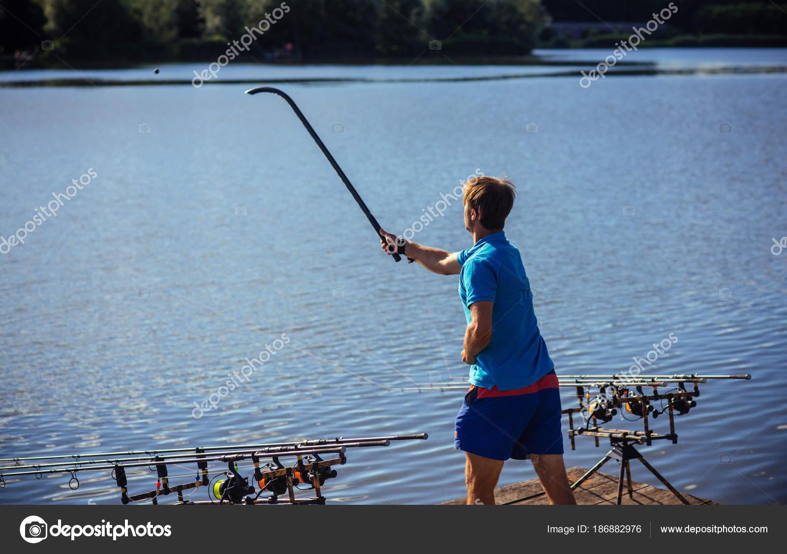 Man Throw Chum Water Fishing Fisherman Attract Fish Bait