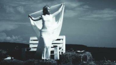 Young girl relaxing. Girl enjoying with summer wind. beautiful girl in white weeding dress. Girl in rustic weeding dress.