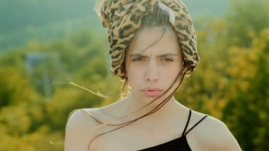 Close Up Portrait of Woman Standing on the Wind. Portrait of a beautiful girl with big full lips.