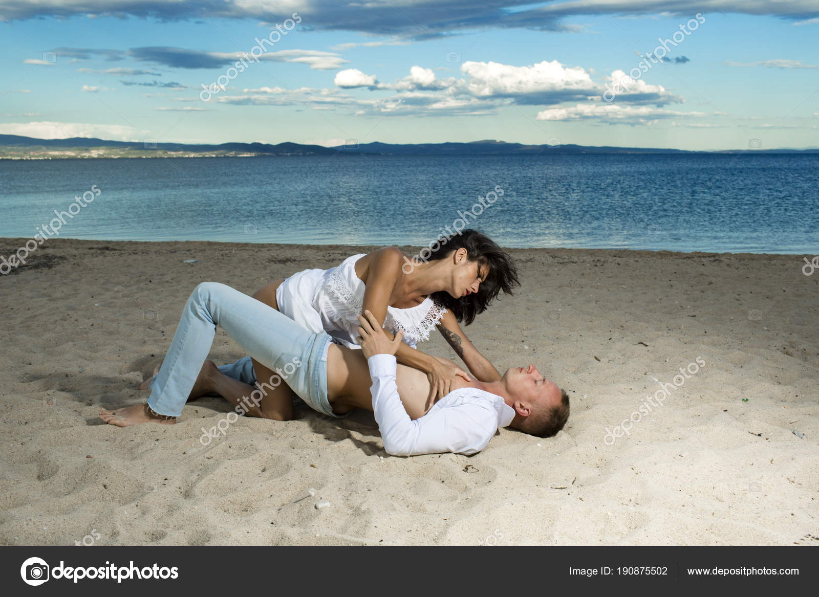 Sex On Beach Concept Couple Full Of Desire Have Sex On Sand Of Seashore Sensual Lovers Making Love At Seashore Sea On Background
