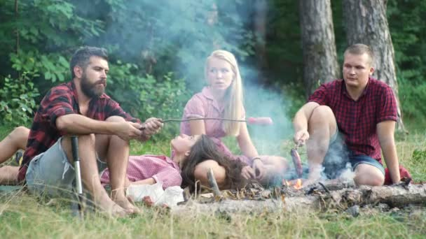 Friends camping eating food concept. Camp forest adventure travel remote relax concept. Young people having a camping