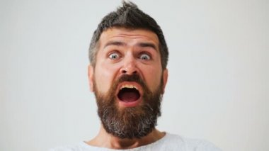 Male facial emotions. Bearded man with different expressions. Young man's portraits with different emotions and gestures. Handsome emotional man. Young man expressing different emotions.