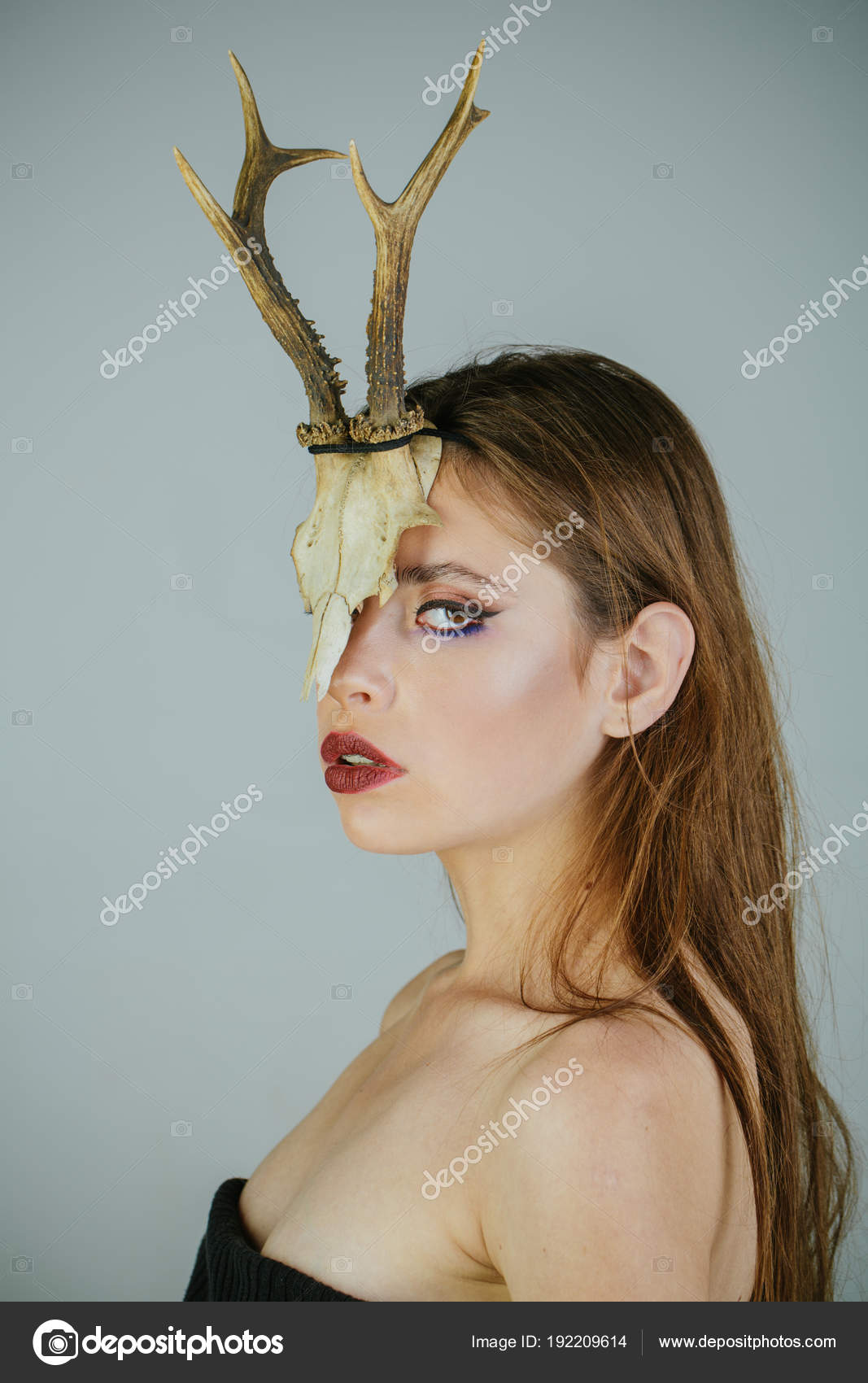 dark fantasy creature elf on halloween in skull woman with makeup and antlers fashion devil of mystic shaman girl with horns beauty look and cosmetics