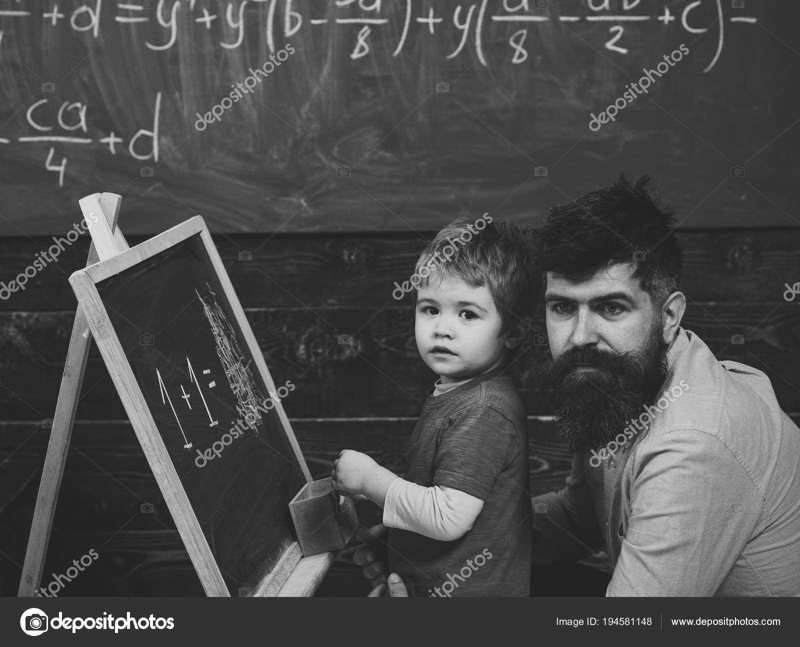 Preschool kid and his teacher in the classroom. Father helping his ...