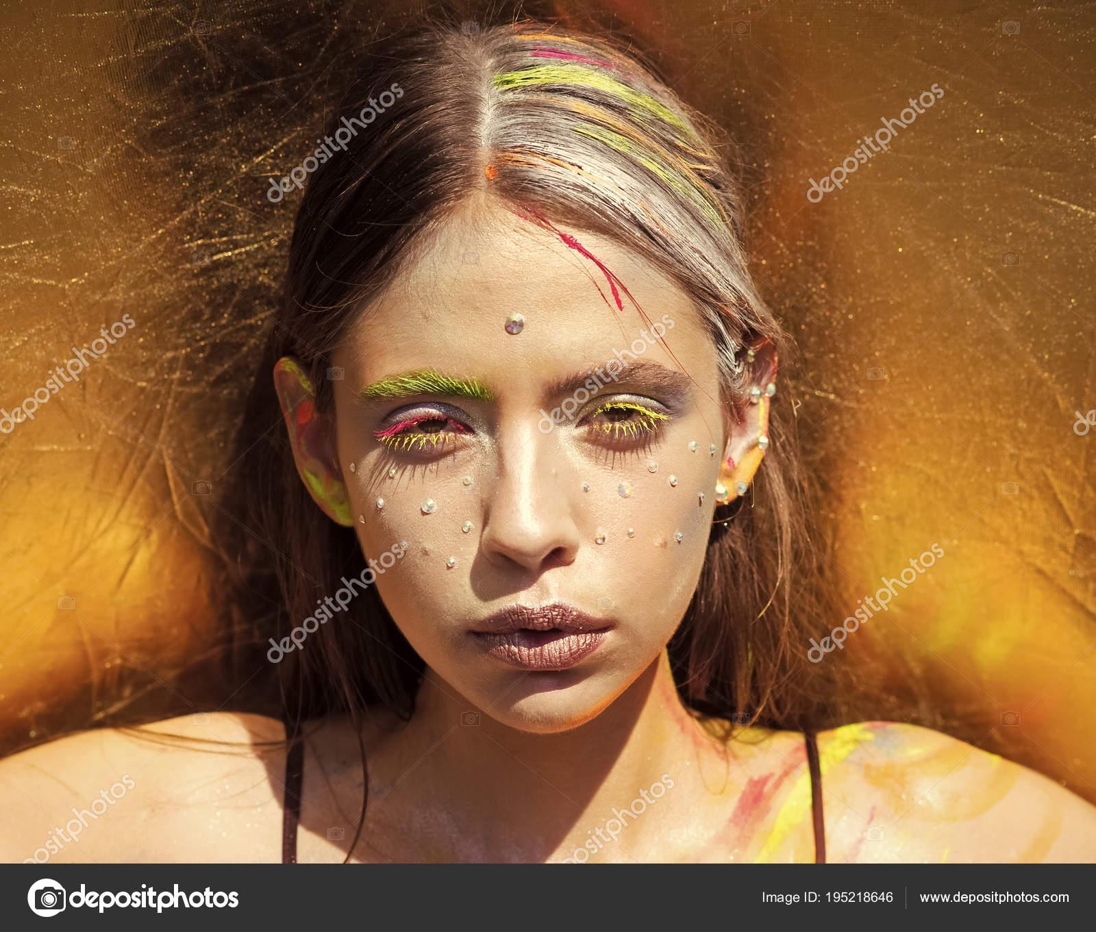 colorful neon paint makeup face