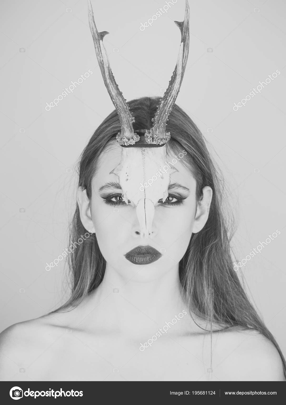 woman with makeup and antlers beauty look and cosmetics for skincare dark fantasy creature elf on halloween in skull chinese horoscope and goat year