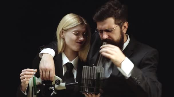 Funny couple and chemistry experiment. A chemistry demonstration. My chemistry experiment. Lesson and education in high school.