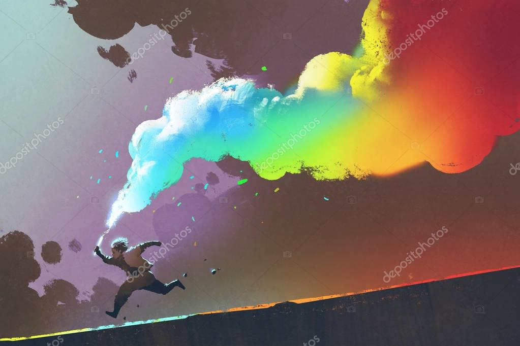 boy running and holding up colorful smoke flare