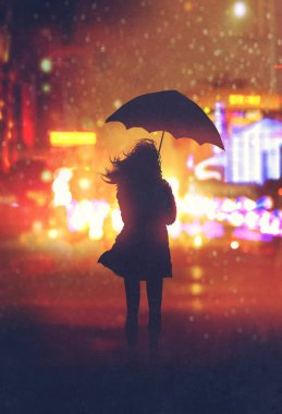 lonely woman with umbrella in night city
