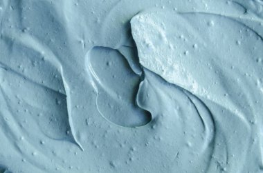 Blue cambrian cosmetic clay texture close up, selective focus. Abstract background
