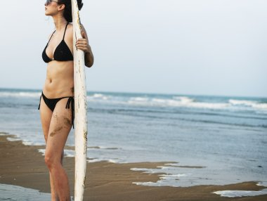 Woman with Surfing board