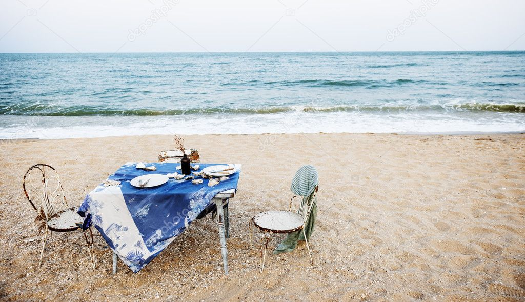 table and chairs on beach