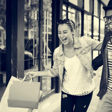woman and man talking while shopping