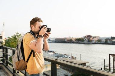 Man with Camera at street