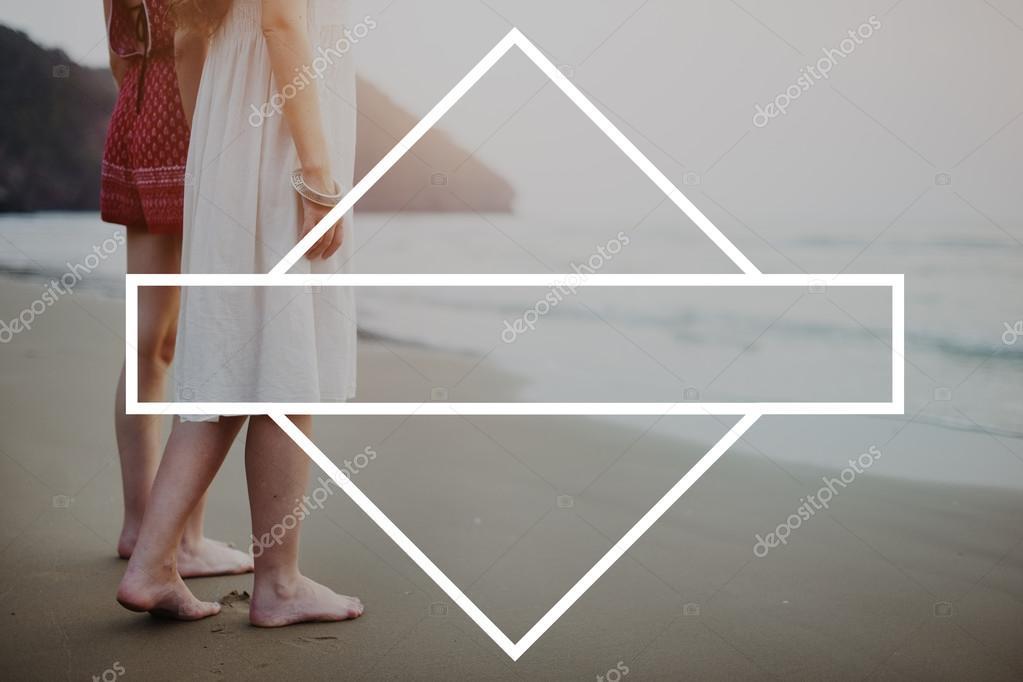 women barefoot at beach