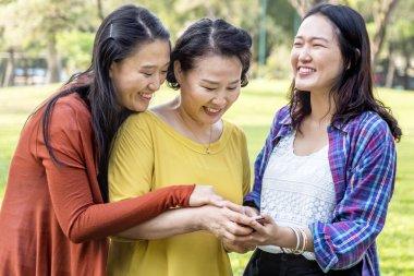 Asian family in park