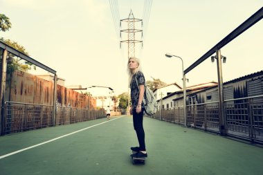 beautiful Woman riding skateboard