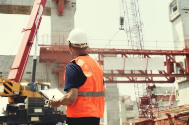 Construction Worker with architecture Plan