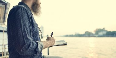 handsome senior man writing notes