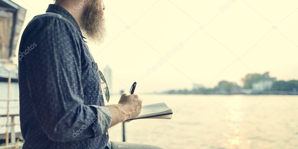 handsome senior man writing notes