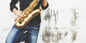Fotografie Young man with Saxophone