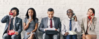 Businesspeople using vintage objects