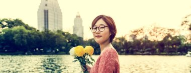 Asian Girl with Flowers