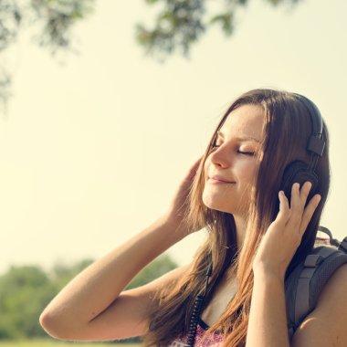 Woman listening music in earphones