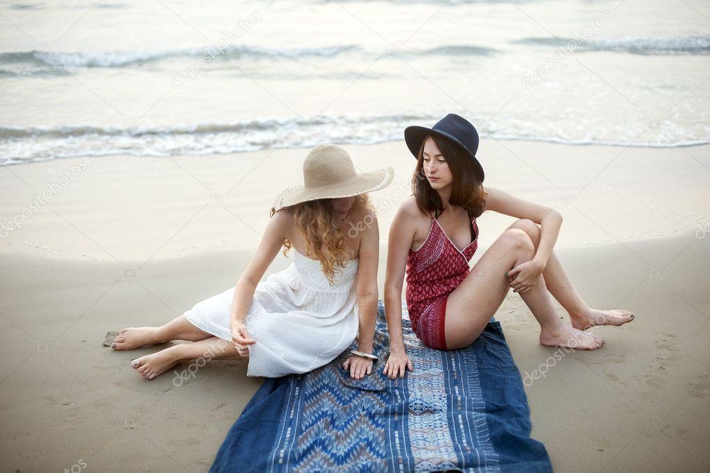 beautiful women chilling near ocean
