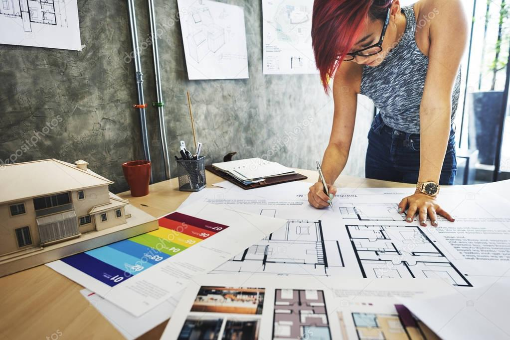 Woman architect with blueprint stock photo rawpixel 129572388 woman architect with blueprint stock photo malvernweather Choice Image