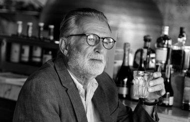 Senior Man drinking in bar