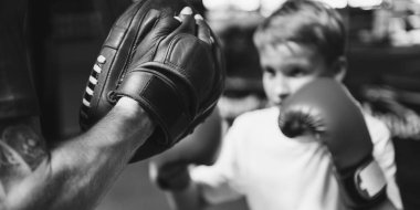 Boy Training Boxing Exercise