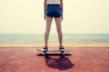 Girl in shorts riding on skateboard