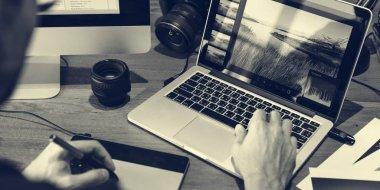 Photographer working on laptop