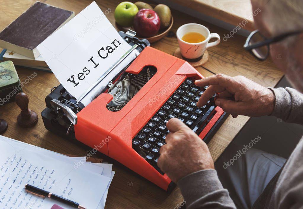 Journalist man typing on typewriting machine