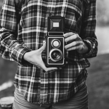 Photographer Holding Camera