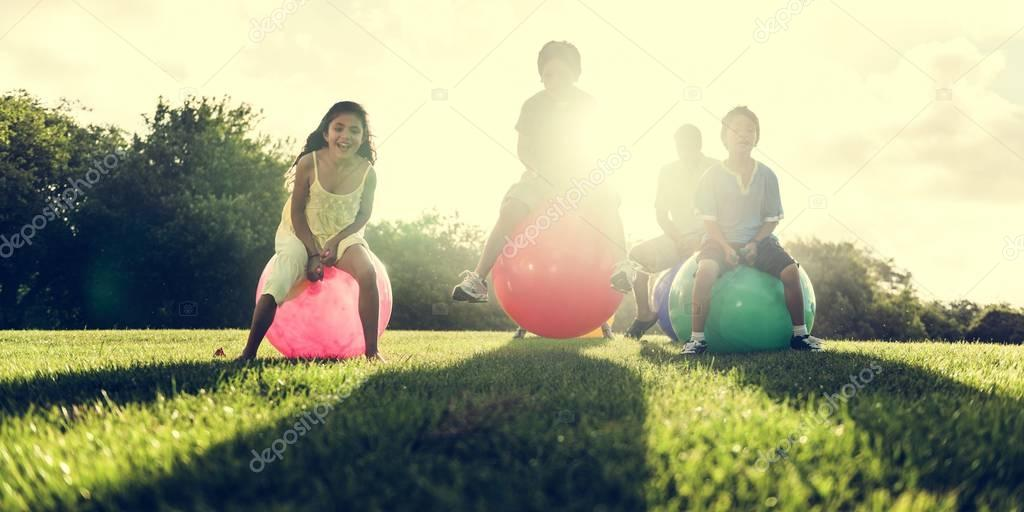 Family jumping on fitness Balls