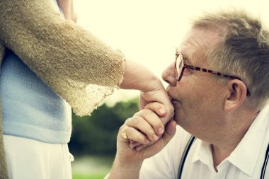 Senior man kissing womans hand