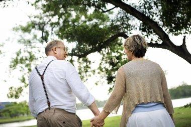 Elderly Senior couple walking in park