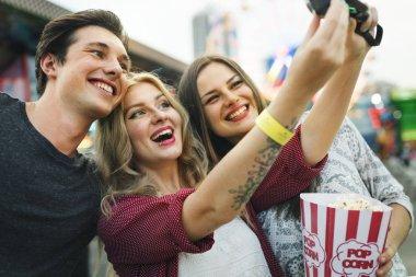 friends making selfie in Amusement Park