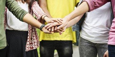 Diverse Teens put Hands Together
