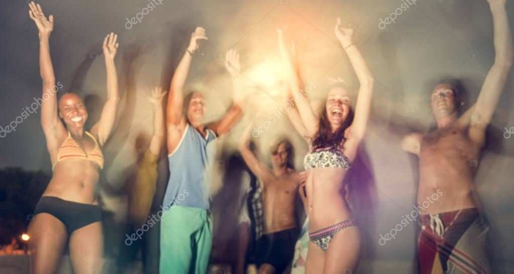 People Dancing on Beach Party
