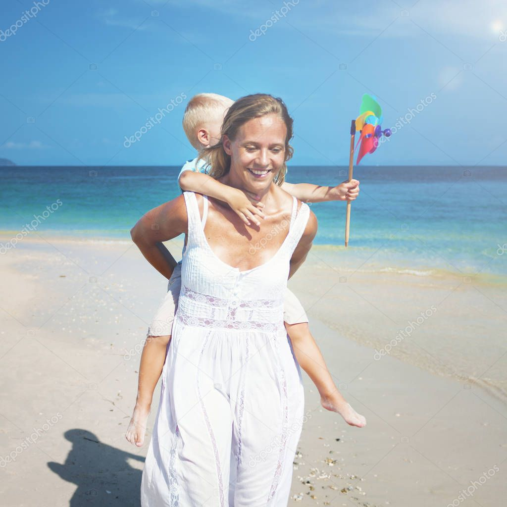 Mother and son having fun on beach