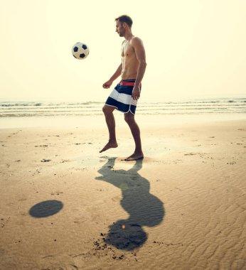 Man playing Beach Football