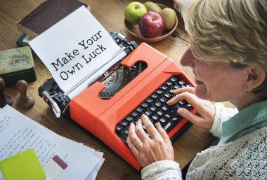 Journalist woman typing on typewriting machine