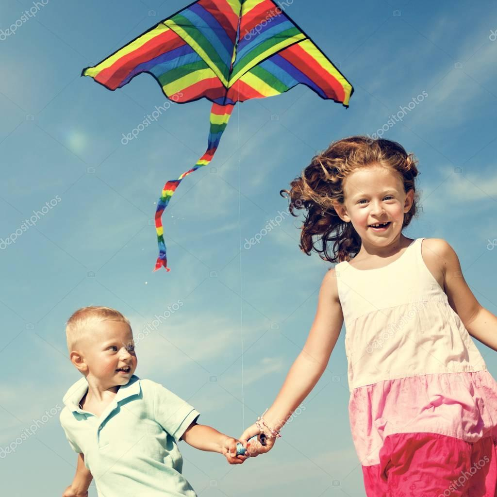 Children Playing Kite on the Beach