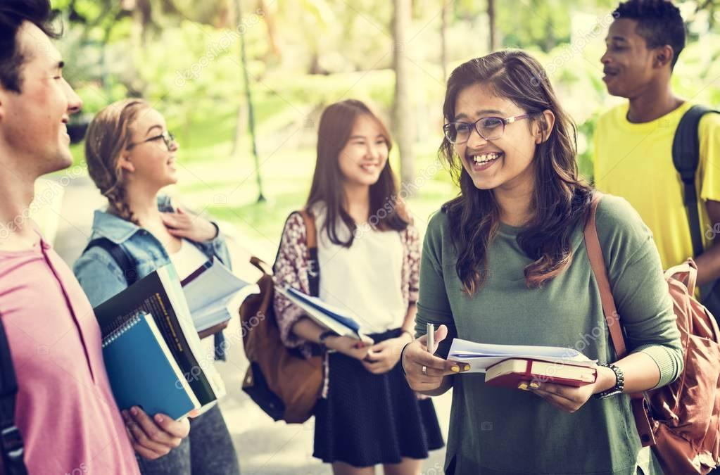 Diverse students studying Outdoors