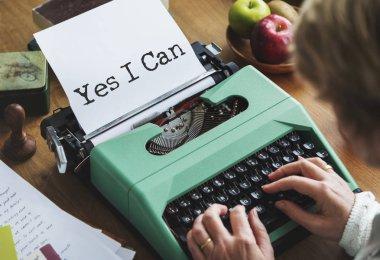 senior woman writing on typewriter machine