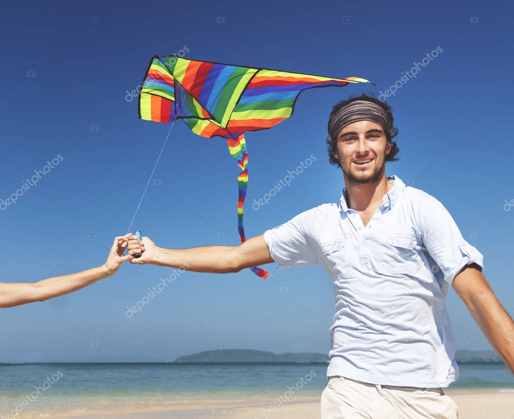 Couple paying kite on beach