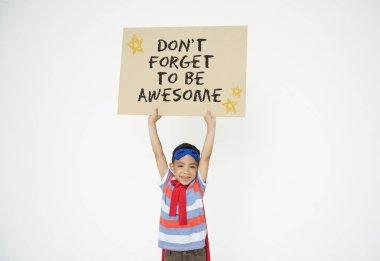 Superhero boy with cardboard in hands